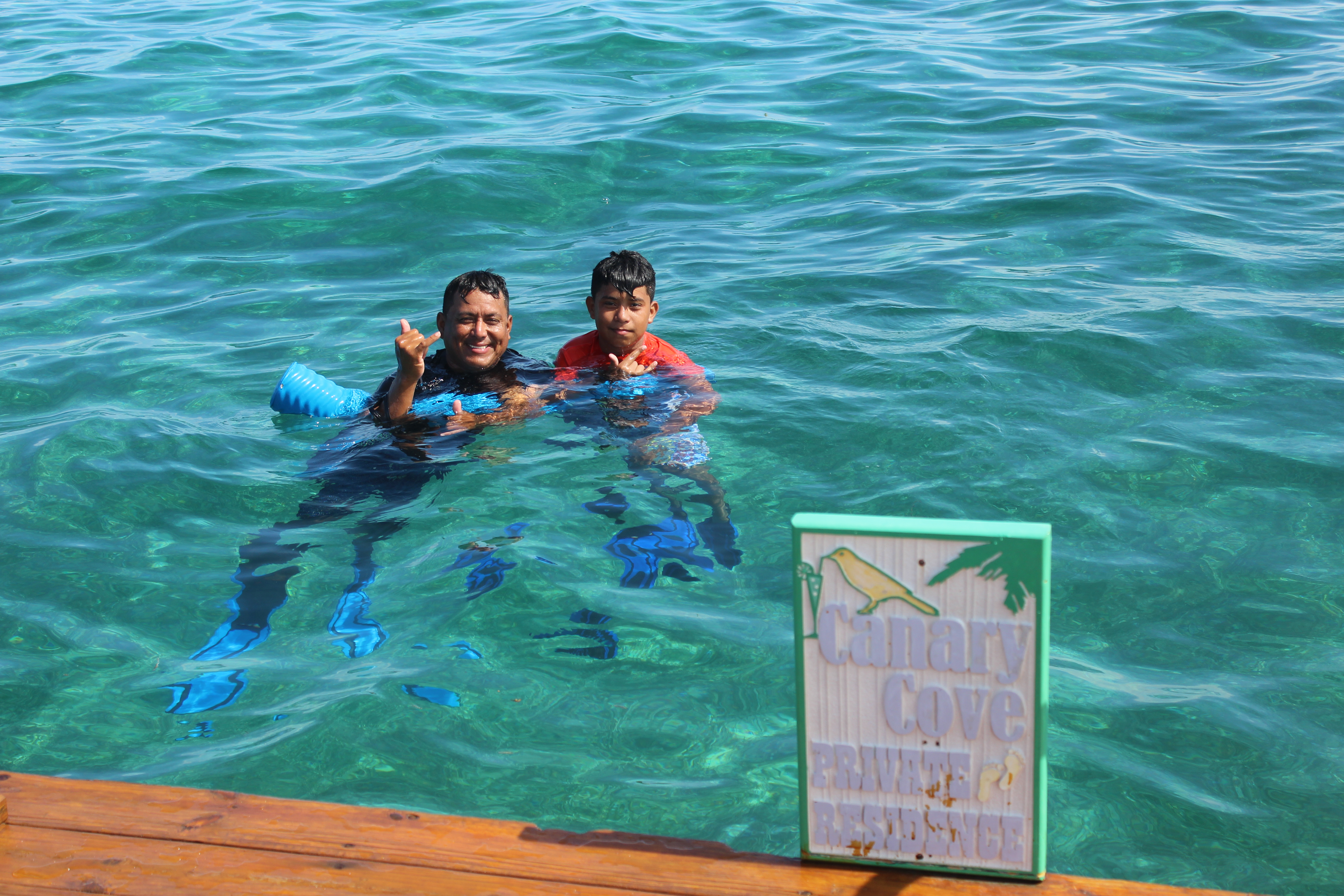 Canary Cove Divemaster Palma Guides Snorkelers at Mexico Rocks from Private Swim Platform