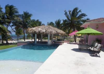 Canary Cove Villa Patio Lounging with Shade Umbrellas